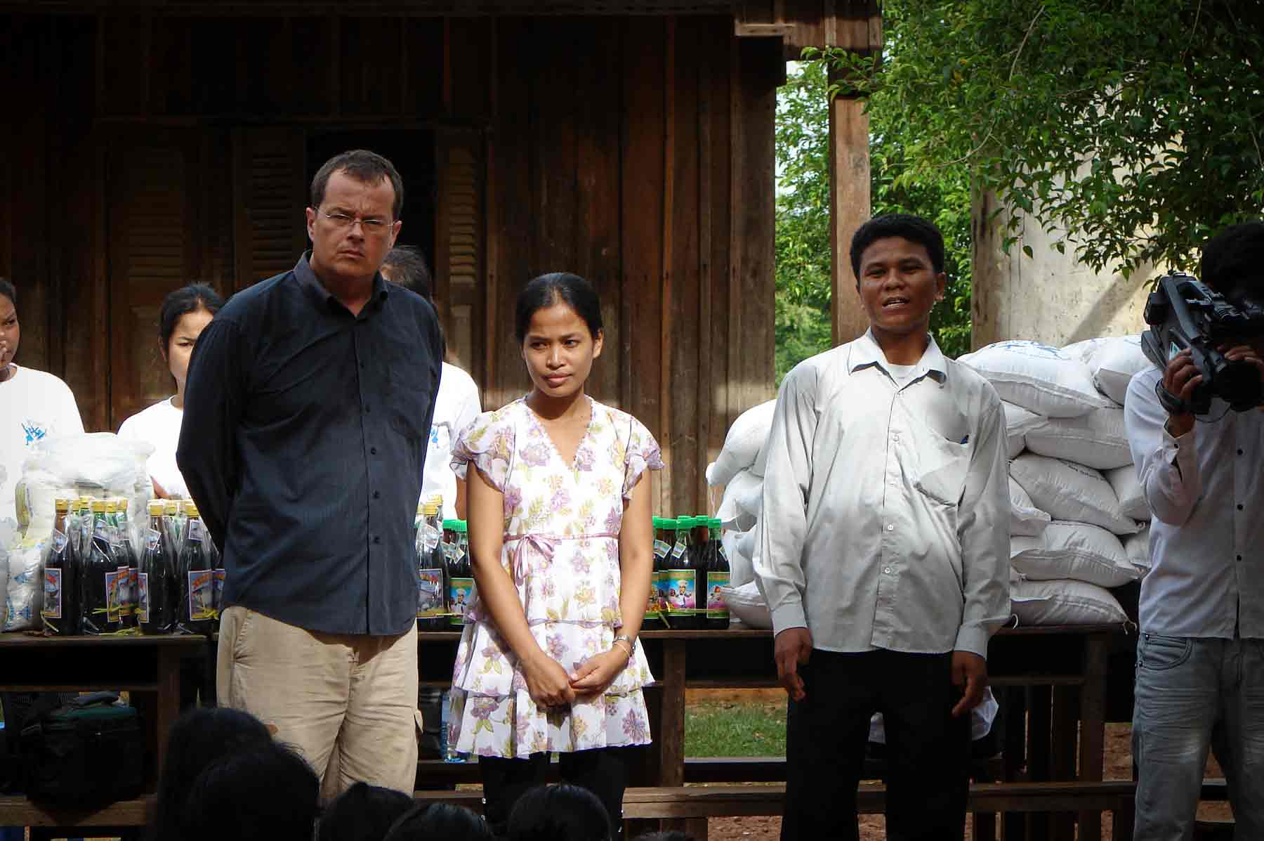 Patrik Roux and his wife Theavy Bun during a humanitarian action in a public school in Cambodia with many very poor children.