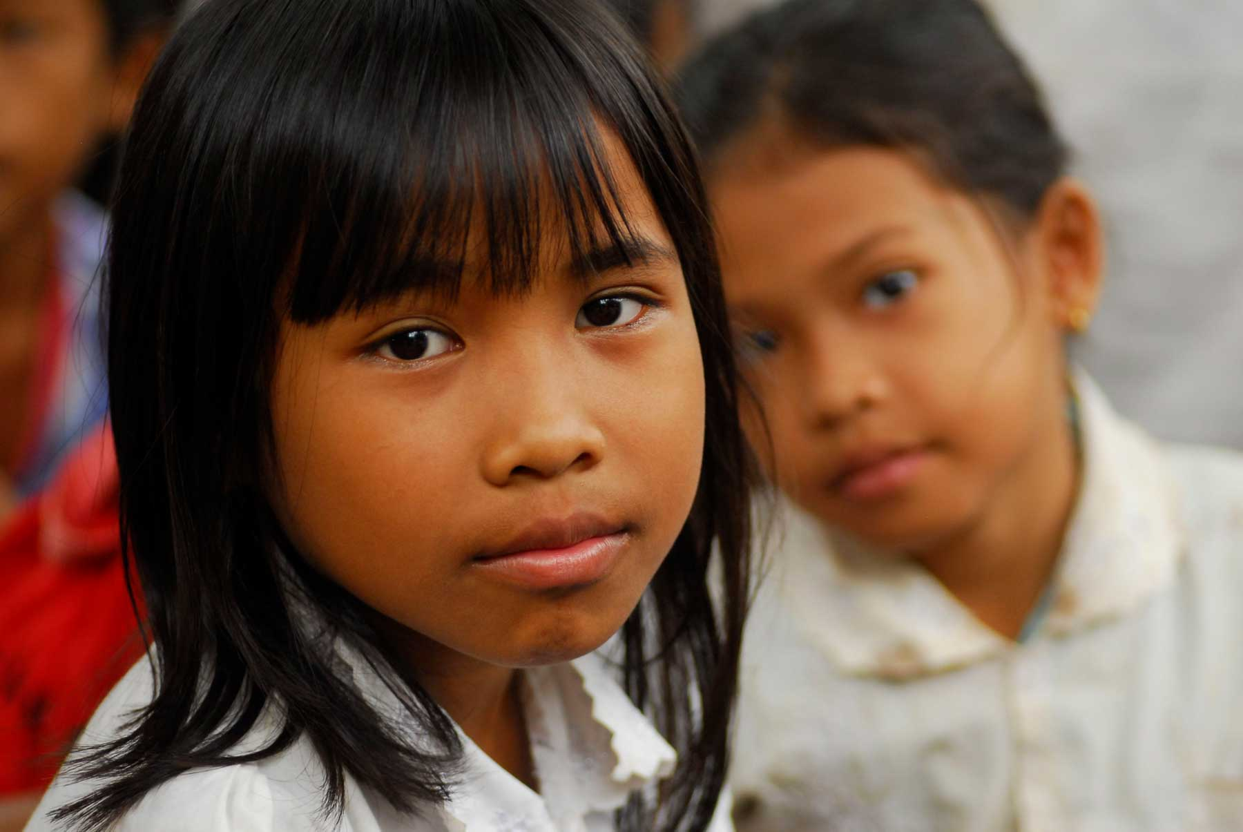 A young Cambodian girl solarised by the NGO AVEC thanks to the sponsorship of the AVEC foundation in Switzerland.