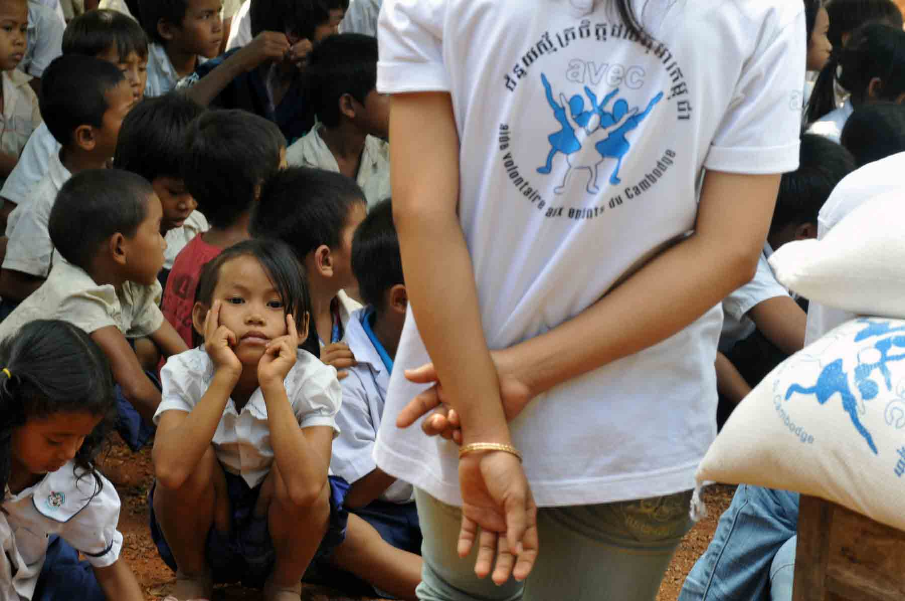 Young volunteer in Cambodia during an education-related humanitarian action with hundreds of children in a public school.