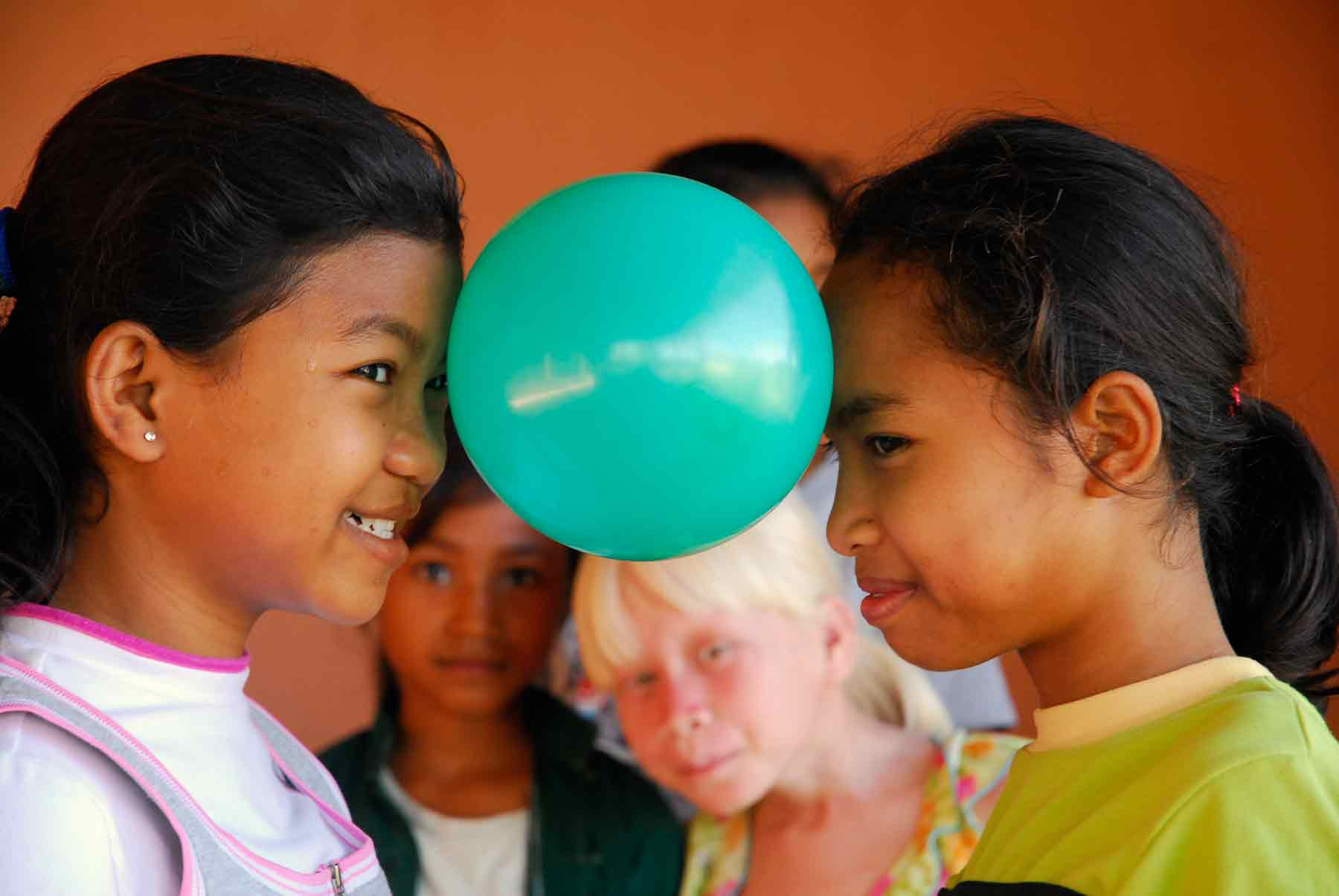 Two orphan girls play in our child protection center in Cambodia.